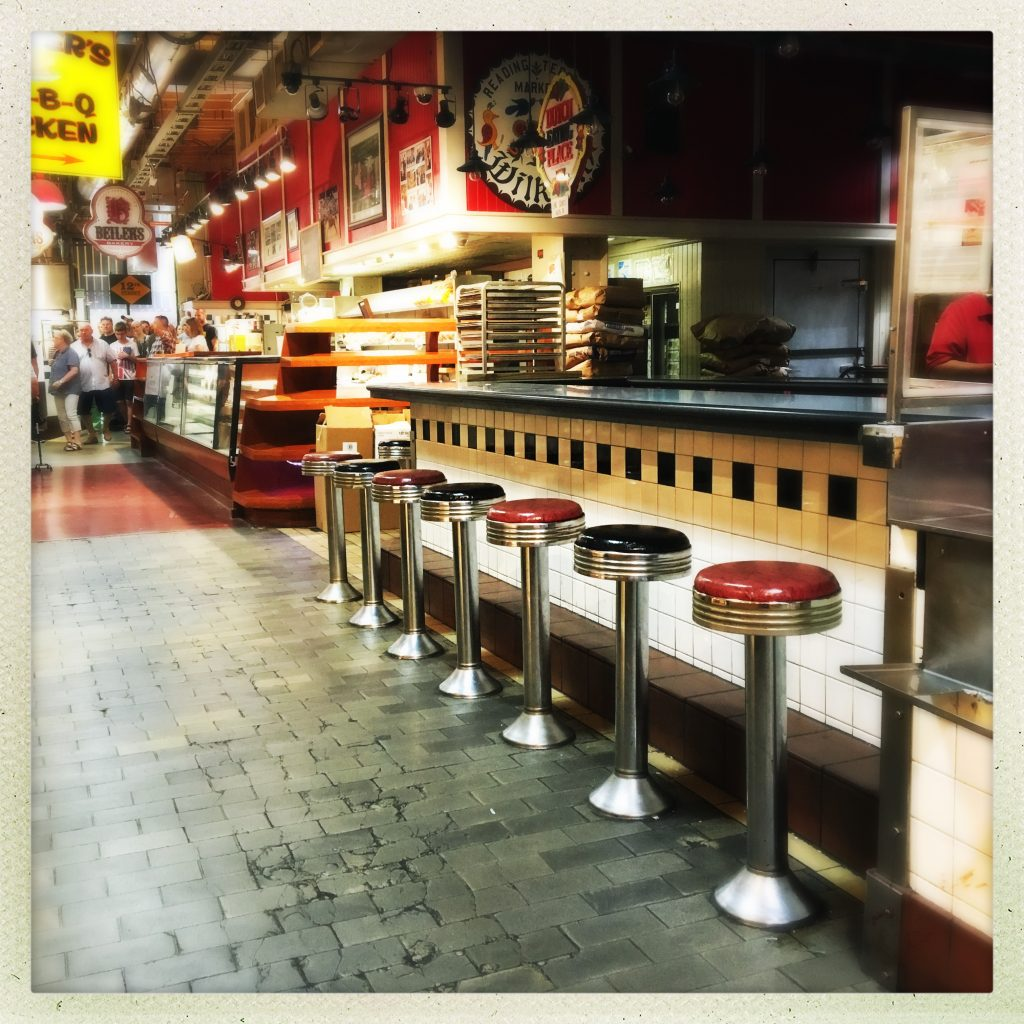empty stools at reading terminal market